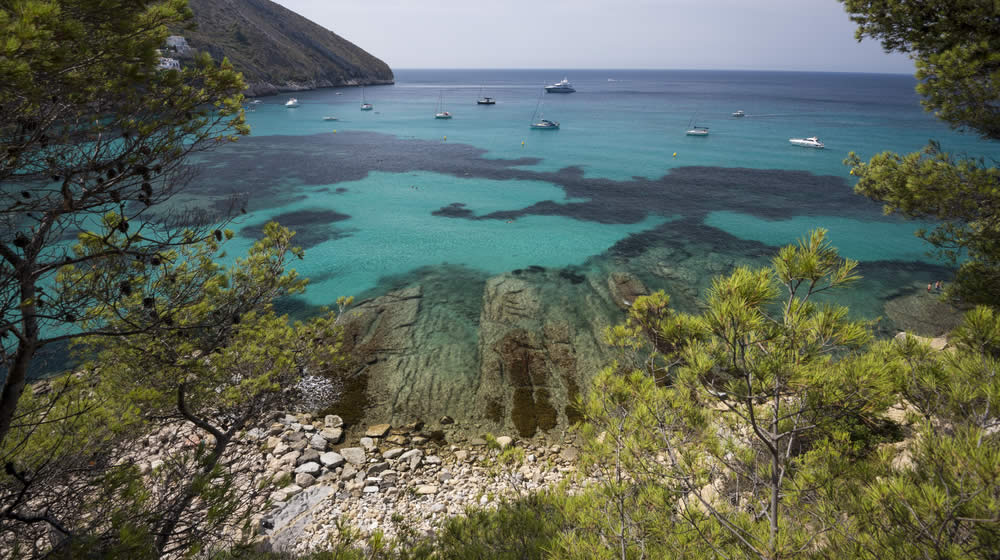 Moraira's clear blue seas, perfect for snorkelling and watersports